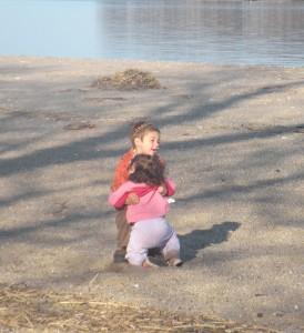 E helping M on beach